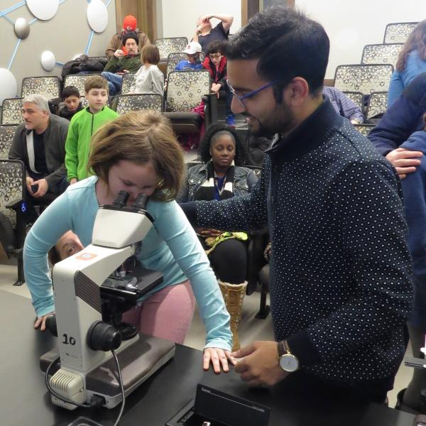 Students look at tardigrades