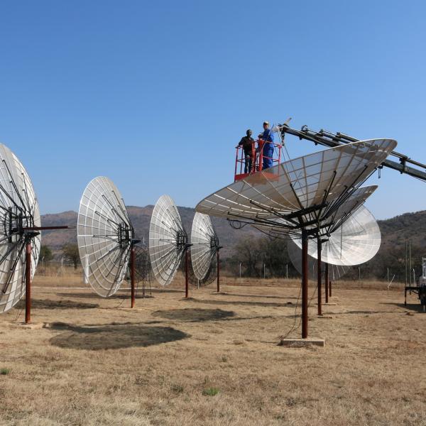 Illuminating the Dark Universe with Radio Observations